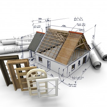 A house under construction, with blueprints and a selection of windows and doors